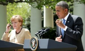 US president Barack Obama and German chancellor Angela Merkel hold a joint news conference in the Rose Garden.